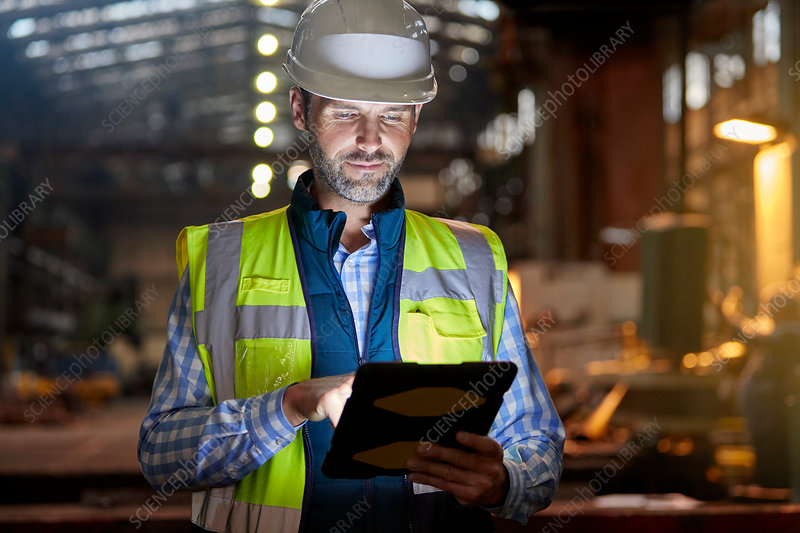 Male engineer working at glowing tablet