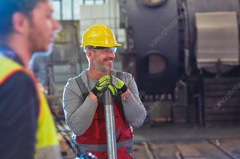 Smiling male engineer in factory