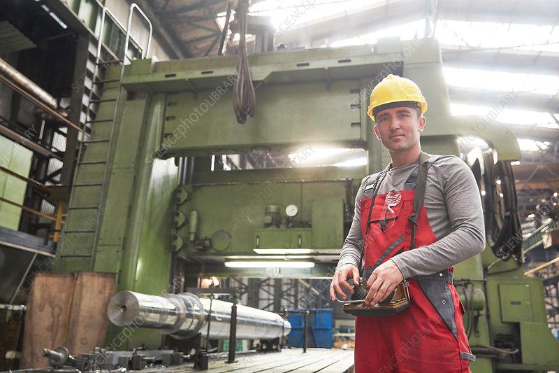 Portrait male worker working in steel factory