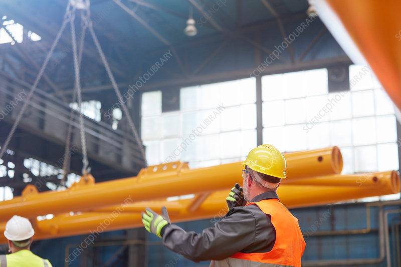 Male worker with walkie-talkie