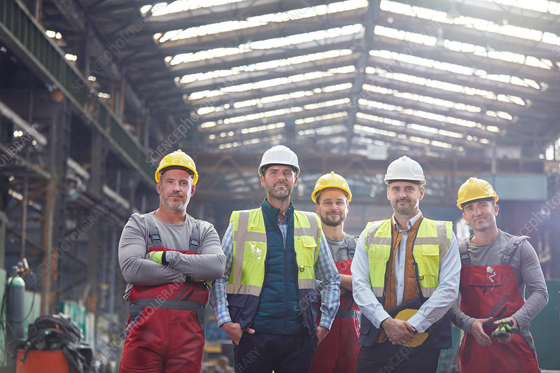 Portrait engineers and workers in factory