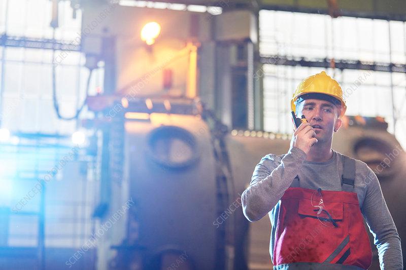 Male worker talking on walkie-talkie