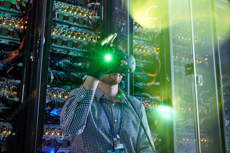Male computer programmer using VR glasses