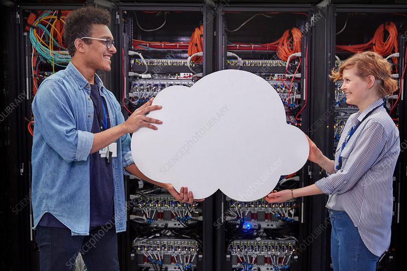 IT technicians holding cloud , cloud computing