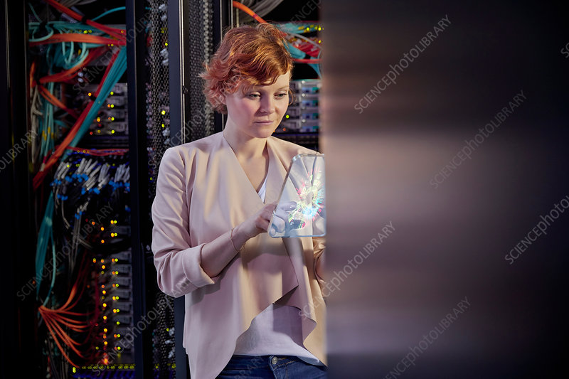 Female IT technician using futuristic tablet