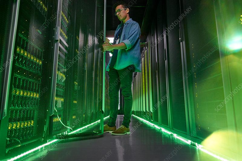 Male IT technician with glowing green panels