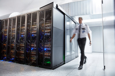Male security guard walking in server room