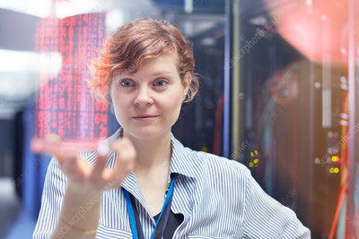 Female IT technician holding futuristic tablet