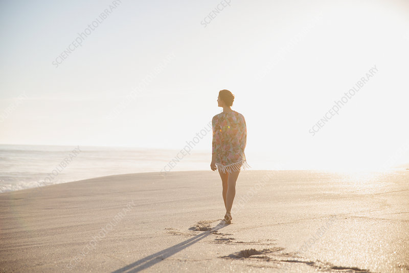 Pensive, serene woman walking