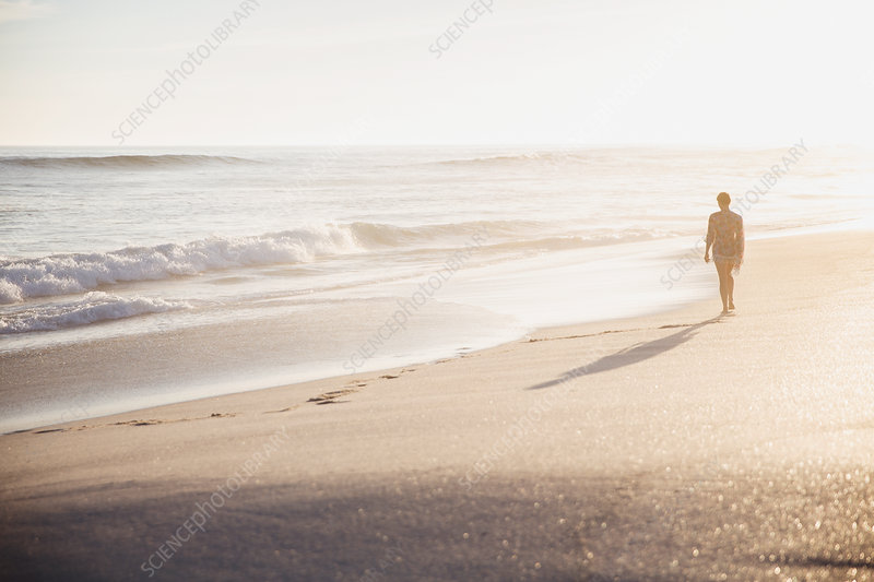 Silhouette woman walking on beach