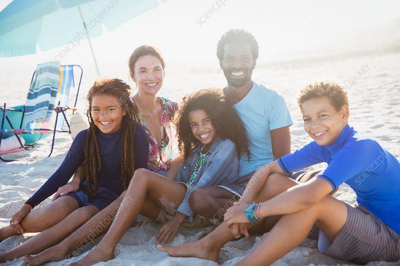Portrait multi-ethnic family on sunny summer beach