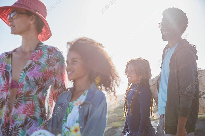 Multi-ethnic family on sunny summer beach
