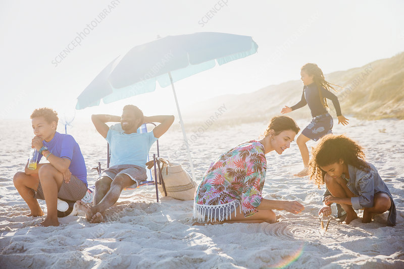 Multi-ethnic family relaxing and playing