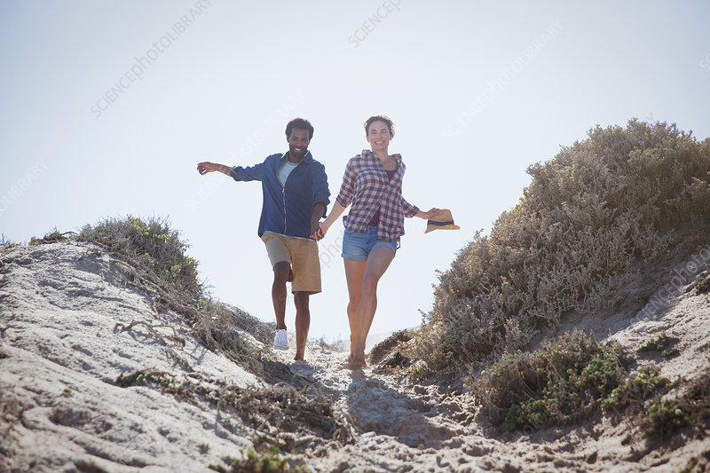 Playful, energetic couple running