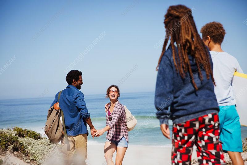 Multi-ethnic family on sunny summer ocean beach