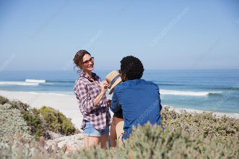 Smiling multi-ethnic couple talking