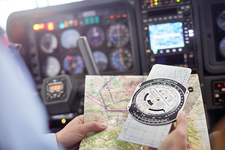 Pilot checking navigational map and compass
