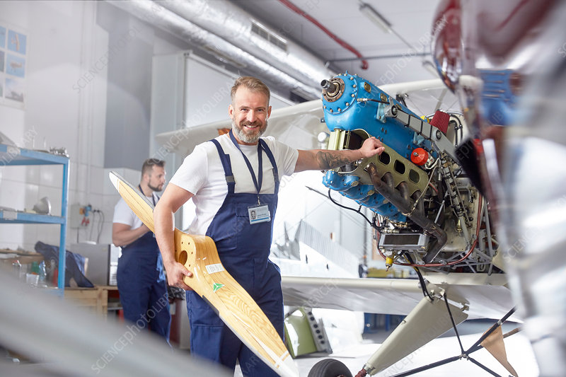 Portrait engineer mechanic working on airplane