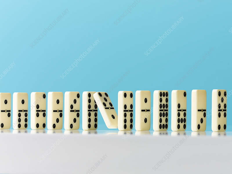 Falling in domino in a row on blue background