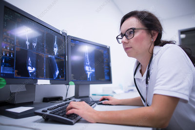 Radiologist studying scans