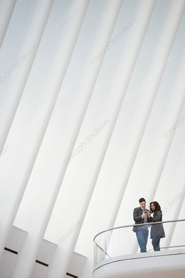 Two people standing on a floating balcony