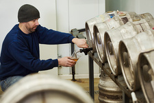 Man testing a brewery batch of beer