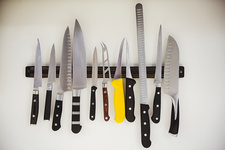 Knives on a magnetic strip in a kitchen