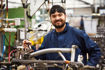 Skilled factory worker in bicycle factory