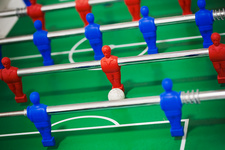 A table football table, ball in play