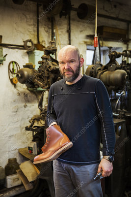 A cobbler in a shoemaker's workshop