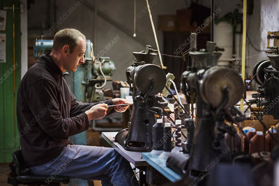 Man at an industrial sewing machine