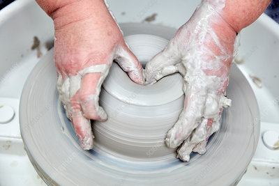 A person using a potter's wheel