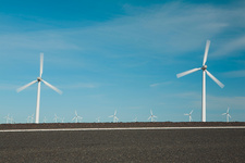 Wind turbines in a row on flat plains