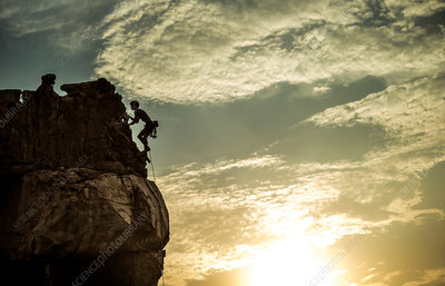 Mountaineer climbing a rock formation