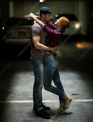 Couple dancing in a parking lot