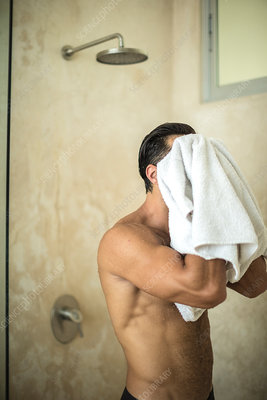 A man drying himself with a towel