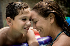 A woman and a boy in a swimming pool