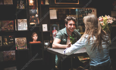 Two young people at a table in a bar