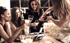 Women at a party drinking champagne