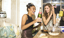 Two young women at a party with champagne