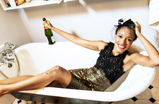 Woman in a bath with a champagne bottle