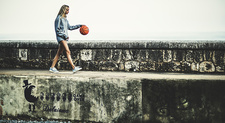 Young woman bouncing a basketball