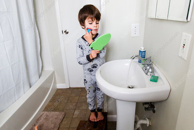 A boy pretending to shave