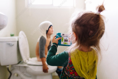 Girl and boy in a bathroom