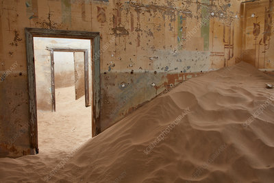 Room in a derelict building full of sand