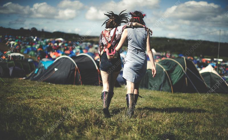 Women at music festival walking