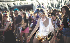Young woman at music festival dancing