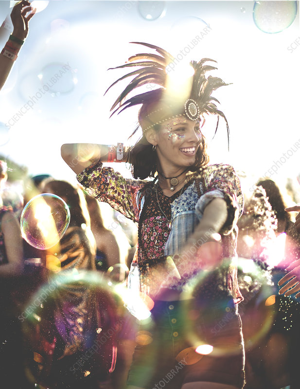 Young woman in feather headdress dancing