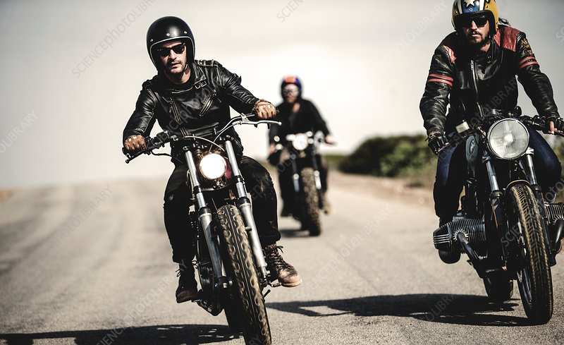 Three men riding cafe racer motorcycles