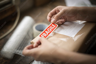 Fragile sticker on a brown paper package